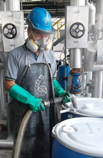 Worker with safety equipment at chemical plant